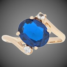 3.31ctw Oval Cut Synthetic Sapphire Ring - 14k Yellow Gold Blue and White Bypass