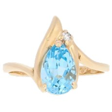 1.99ctw Pear Cut Blue Topaz & Diamond Ring - 14k Yellow Gold Bypass