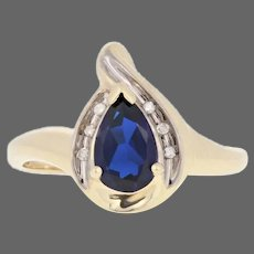 Yellow Gold Synthetic Sapphire & Diamond Ring - 10k Pear Cut .87ctw Bypass