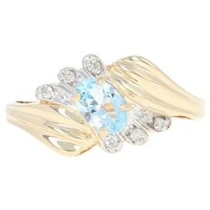 Blue Topaz & Diamond Bypass Ring - 14k Yellow Gold Oval Brilliant .83ctw