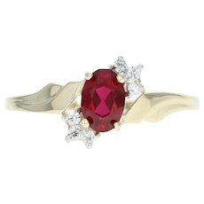 Synthetic Ruby & Cubic Zirconia Bypass Ring - 10k Yellow Gold 0.63ctw