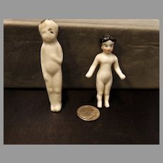 2 Antique Porcelain Frozen Charlotte Miniatures
