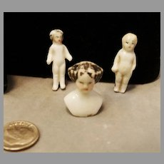 Miniature Flat Top China Head With 2 Tiny Frozen Charlotte Dolls