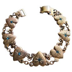 Victorian Revival Vintage Costume Puffy Heart Charm Bracelet with Blue Crystals Rhinestones Light Rose Gold Hue to Plating