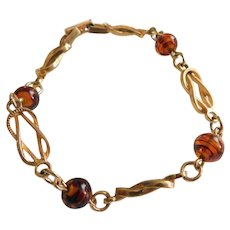 Attractive Vintage AVON Bracelet Swirled Caramel Brown Art Glass Accents on Gold