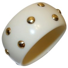 Vintage Wide Cream Lucite Bangle Bracelet with Embedded Gold Tone Metal Studs