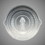 Antique glass cake plate Venus Cupid Richards Hartley c. 1880s Minerva