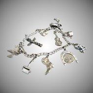 Vintage charm bracelet Southwest sterling silver mechanical charm c. 1940's