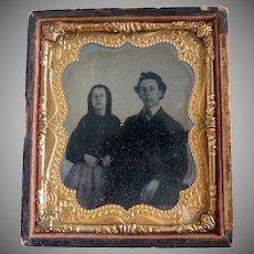 Antique daguerreotype girl and man portrait c. 1850s
