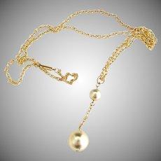 Vintage gold necklace dangle ball mid-Century modern