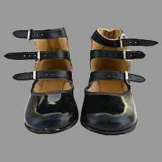 Vintage patent leather black strappy girls shoes c. 1950s