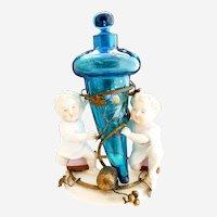 Antique German bisque figural perfume stand bluerina bottle