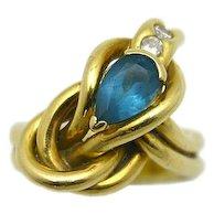 18karat Yellow Gold Blue Topaz and Diamond Knot Motif Ring