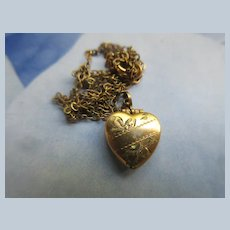 Circa 1920 Puffy Heart Charm Locket Necklace in Gold Fill