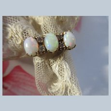 Older Vintage 10K Opal Trilogy Ring with White Sapphire Accents
