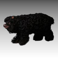 "8"" Long black Lambskin Covered Paper Mache Bear Cub"