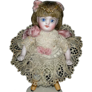 """GORGEOUS ALL BISQUE - 4 1/2"""" - Fully Jointed with a Swivel Head & Blue Glass Eyes - Rare Yellow Boots - Full Lips - #208"""
