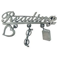 For the Student or Teacher, here is a funky pin! Signed JJ Jonette Jewelry Reading dangling pin, brooch.