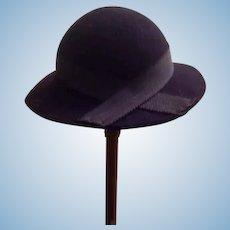Cute black felt hat.