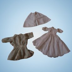 Three pieces of vintage doll clothing