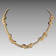 Vintage Anne Klein love knot gold plate necklace
