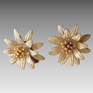 Vintage starburst flower clip on earrings