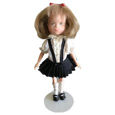 Madame Alexander Eloise Doll on stand