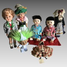 Six Vintage Travel Dolls and a Troll