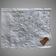 Richly embroidered white on white handkerchief