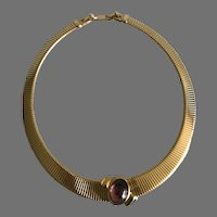 Vintage Monet Gold Tone Ribbed Collar with Faux Amethyst Cabochon