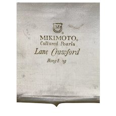 Mikimoto cultured pearl brocade and satin storage case for necklace