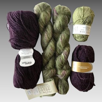 Six skeins of yarn in complementary colors