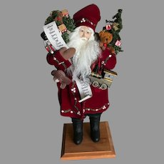 Lynn Haney Artist Santa With His List and Arms Full of Christmas