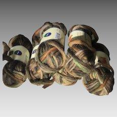 Six skeins of earth tones Merino wool yarn