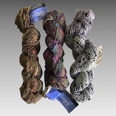 Three large skeins of fancy knitting yarn