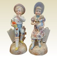 Very Fine Heubach Style Antique Pair of Porcelain Figurines - Children Boy and Girl Holding Toys