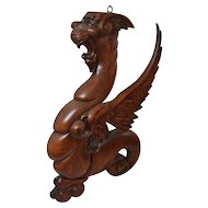 Pair of Carved Oak winged Griffins.
