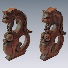 Pair of Outstanding Quartersawn Oak Carved Wrap Tail Griffins