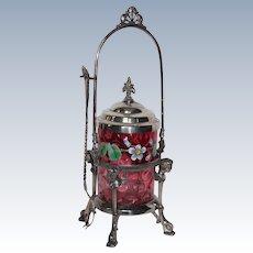 Figural Cherub Pickle Castor with Cranberry Optic Dot Enameled Floral Decoration