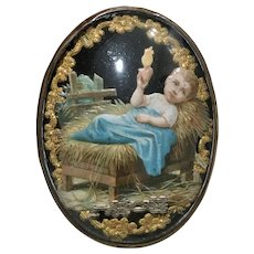 Antique Baby Jesus French Reliquary in Oval Convex Glass and Brass Frame