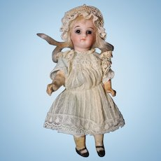 German Bisque head doll marked 13 composition body