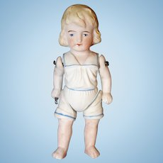 German All Bisque Doll in Molded Clothing