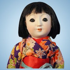 Early Ichimatsu Japanese Bisque doll with ball jointed body