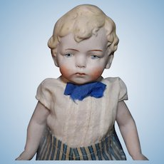 German All Bisque Boy with molded hair