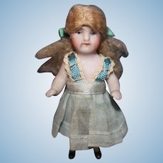 Tiny All Bisque Doll with Frozen arms and legs