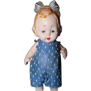 All Bisque Girl with molded hair and bow