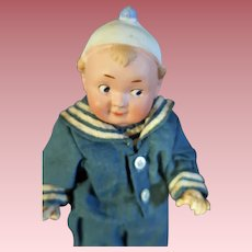 Recknagel Googly Doll with Molded Hat Bisque Head composition body