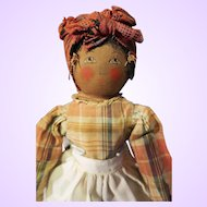 Early Black Babyland Cloth doll painted features