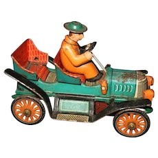 Tin Toy Old Time Car Friction toy marked TKK