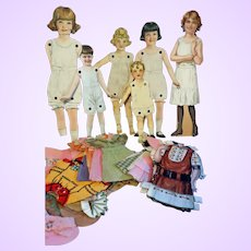 Group Jointed Paper Dolls and crepe paper clothing